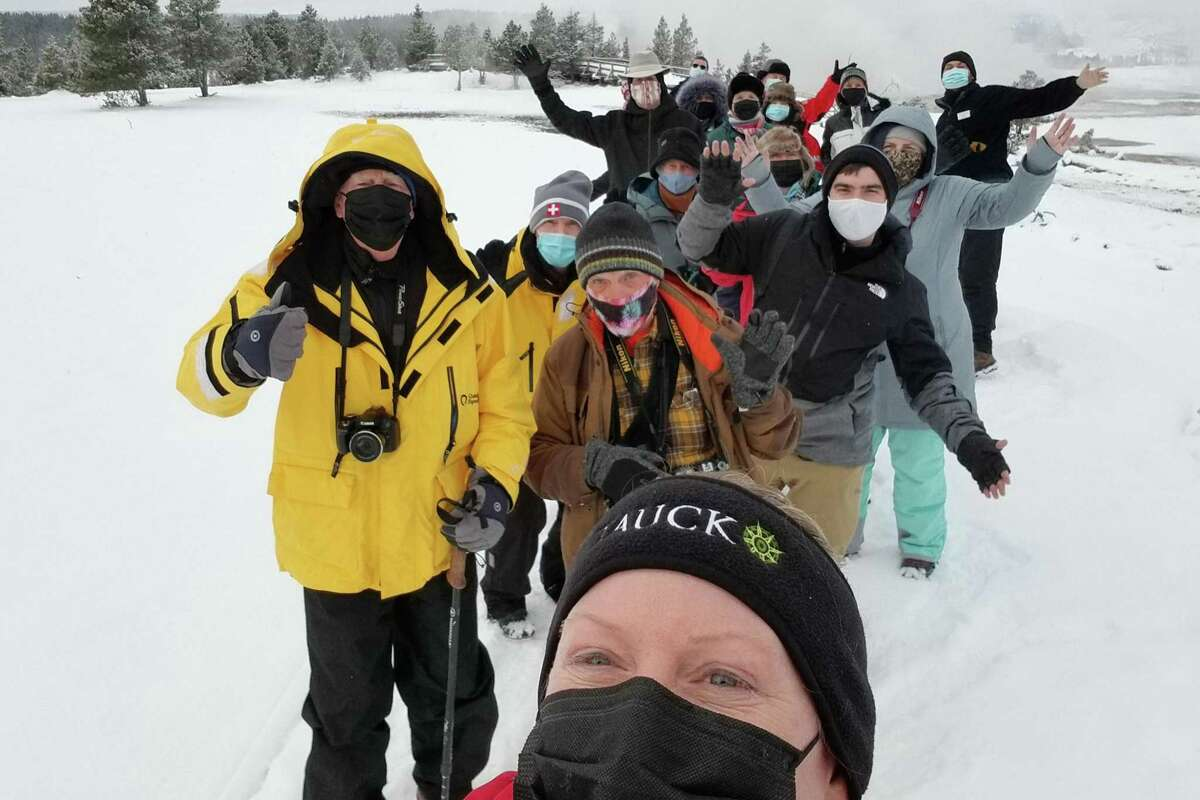 A Tauck guide takes a selfie of a group tour at Yellowstone National Park in Wyoming last month.