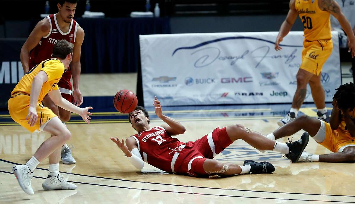 Stanford's Oscar da Silva corrals a loose ball against California in 1st half during Pac 12 men's basketball game at Haas Pavilion in Berkeley, Calif., on Thursday, February 4, 2021.
