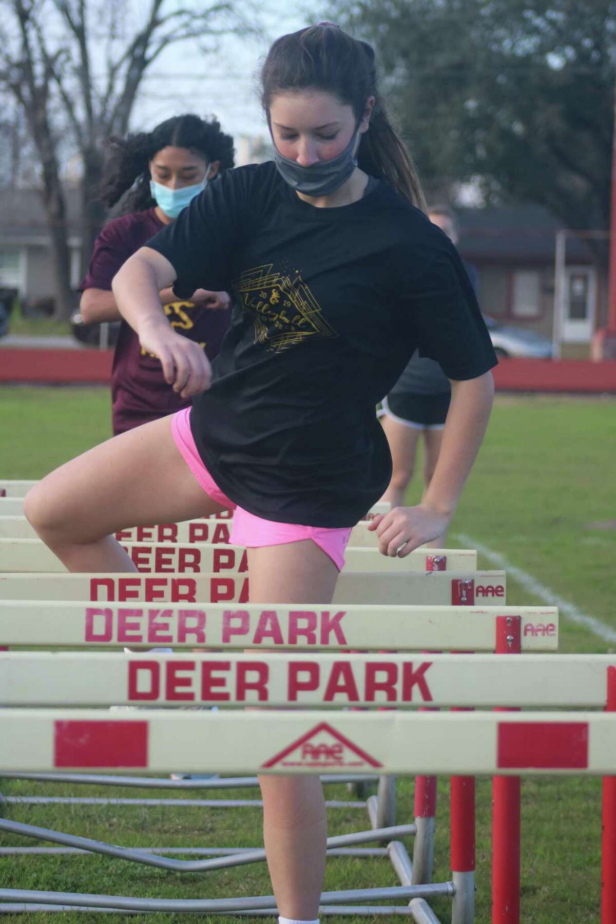 Sophomore hurdler Kayleigh Dyson works on her technique during a Wednesday practice.