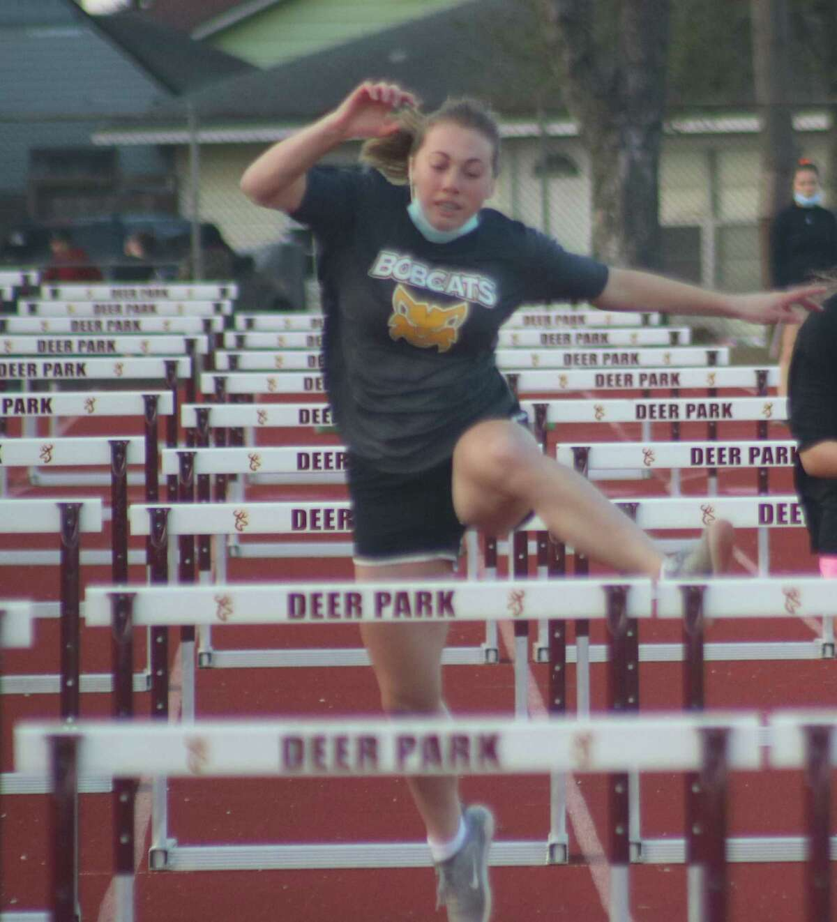 Alyssa Carroll tries out a series of hurdles at McLean Stadium Wednesday. She'll see how she stacks up against other hurdlers on Friday for the first test of the new track and field season.