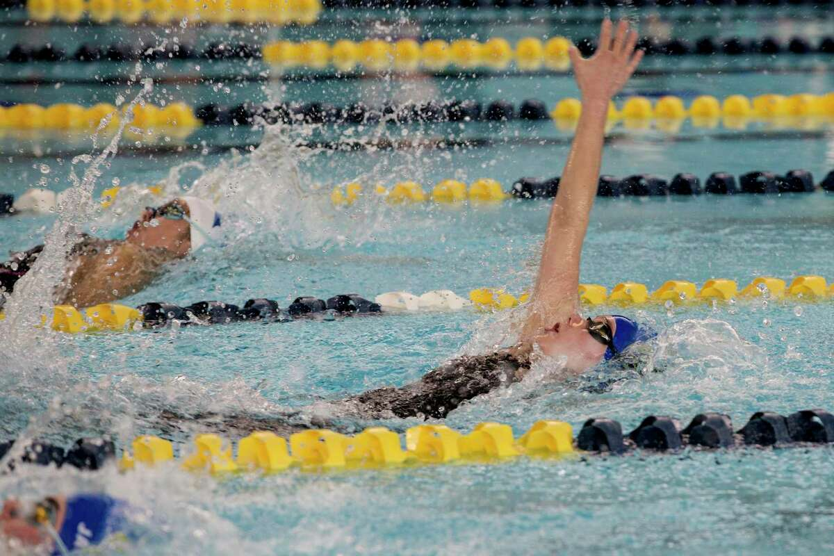 Lila Foote of Alamo Heights wins the 100 Yard Backstroke at the UIL Region VII-5A girls swimming meet Thursday February 4, 2021 with a time of 56.82.