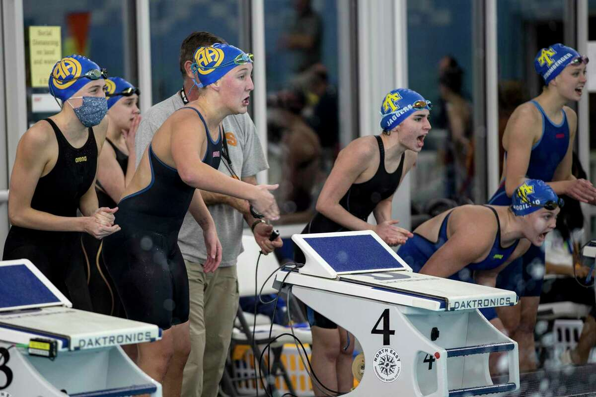 The 200 Yard Freestyle relay teams of Alamo Heights and Anderson cheer their teams on as the last swimmers in the race finish. Alamo Heights beat Anderson with a time of 3:39.31, .37 seconds faster than Anderson.