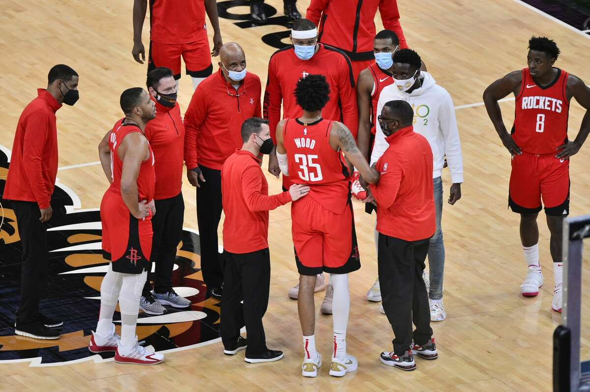 Houston Rockets center Christian Wood (35) receives attention sustaining an injury in the second half of an NBA basketball game against the Memphis Grizzlies Thursday, Feb. 4, 2021, in Memphis, Tenn. (AP Photo/Brandon Dill)