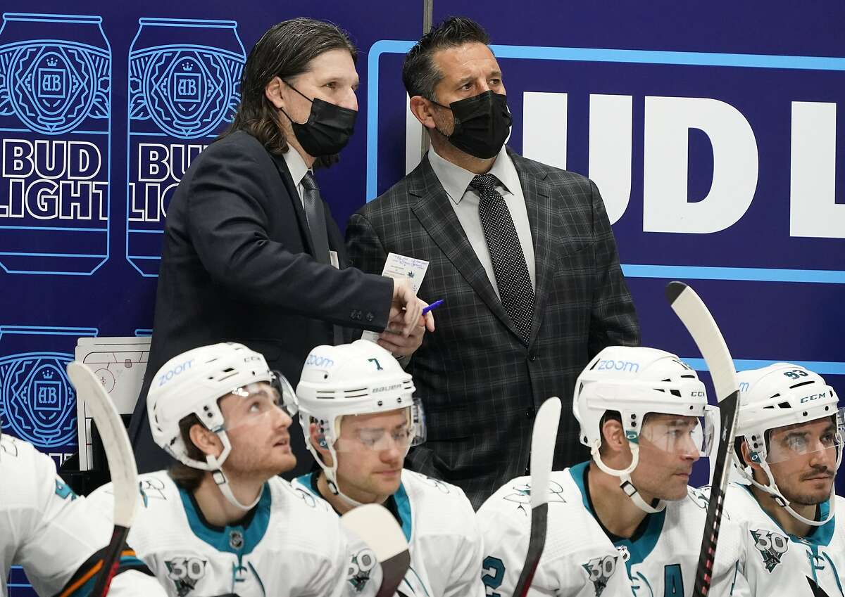 San Jose Sharks coach Bob Boughner, right, confers with assistant coach Mike Ricci during the second period of the team's Jan. 26 game against Colorado.