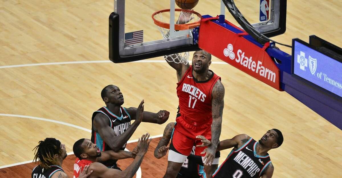 Houston Rockets forward P.J. Tucker (17) shoots over Memphis Grizzlies center Gorgui Dieng (14) and guard De'Anthony Melton (0) in the second half of an NBA basketball game Thursday, Feb. 4, 2021, in Memphis, Tenn. (AP Photo/Brandon Dill)