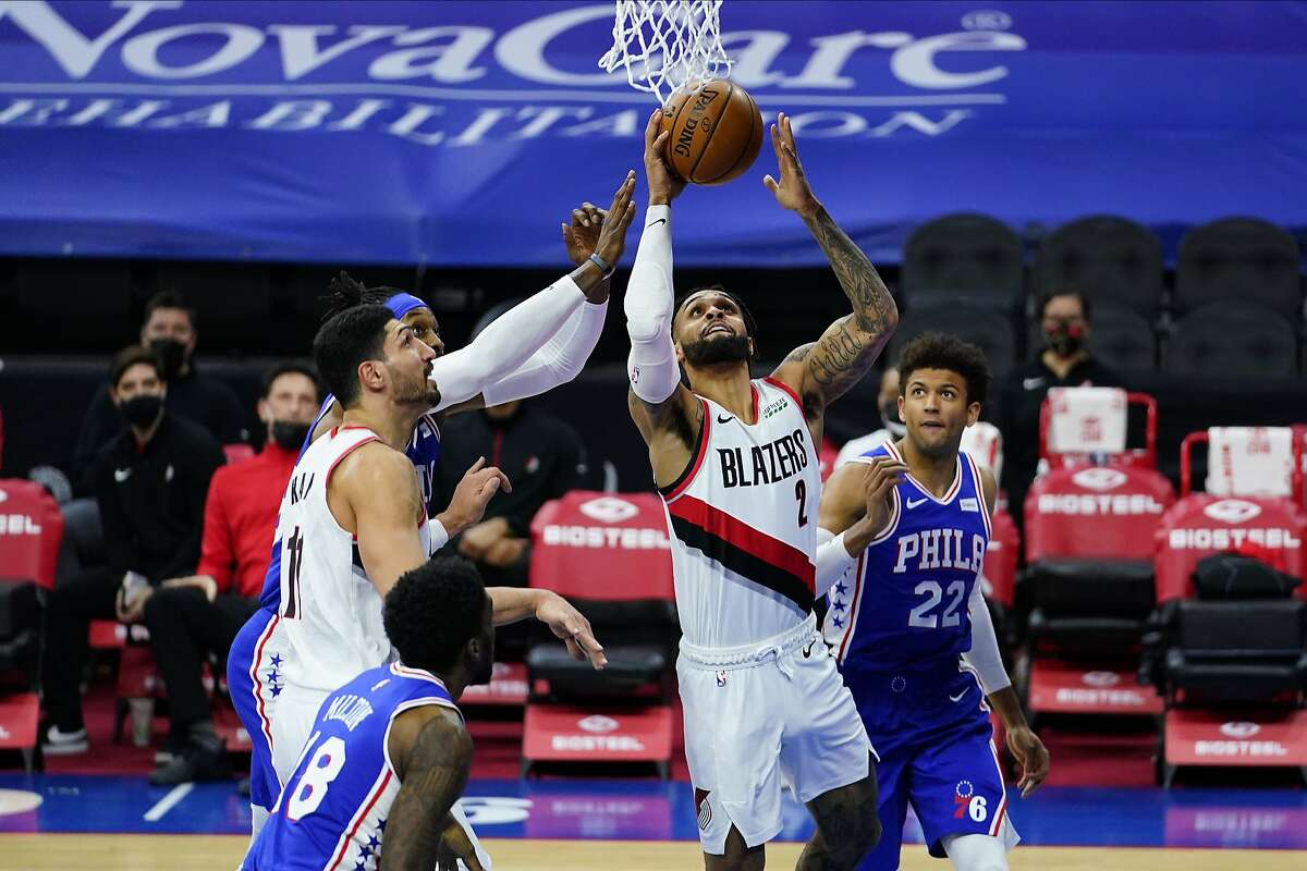 Gary Trent Jr. hit a pair of 3-pointers as Portland outscored the Sixers 40-19 in the third period in Philadelphia.