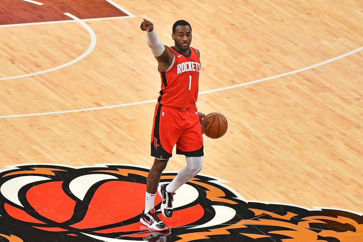 MEMPHIS, TENNESSEE - FEBRUARY 04: John Wall #1 of the Houston Rockets brings the ball up court during the second half against the Memphis Grizzlies at FedExForum on February 04, 2021 in Memphis, Tennessee. NOTE TO USER: User expressly acknowledges and agrees that, by downloading and/or using this photograph, user is consenting to the terms and conditions of the Getty Images License Agreement. (Photo by Justin Ford/Getty Images)