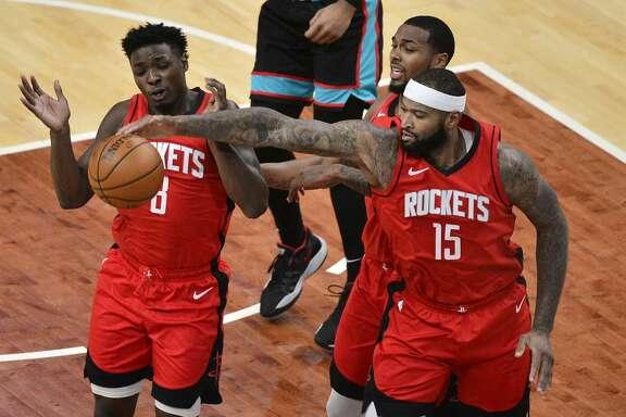 Houston Rockets forward Jae'Sean Tate (8), center DeMarcus Cousins (15), and guard Sterling Brown (0) reach for the ball during the first half of the team's NBA basketball game against the Memphis Grizzlies on Thursday, Feb. 4, 2021, in Memphis, Tenn. (AP Photo/Brandon Dill)