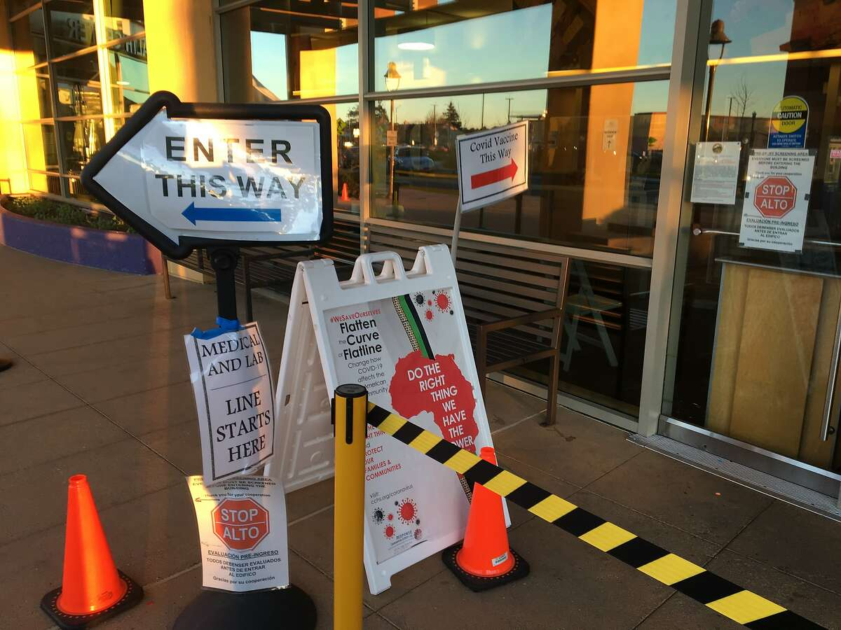 Signs guide visitors to the West County Health Center in San Pablo.