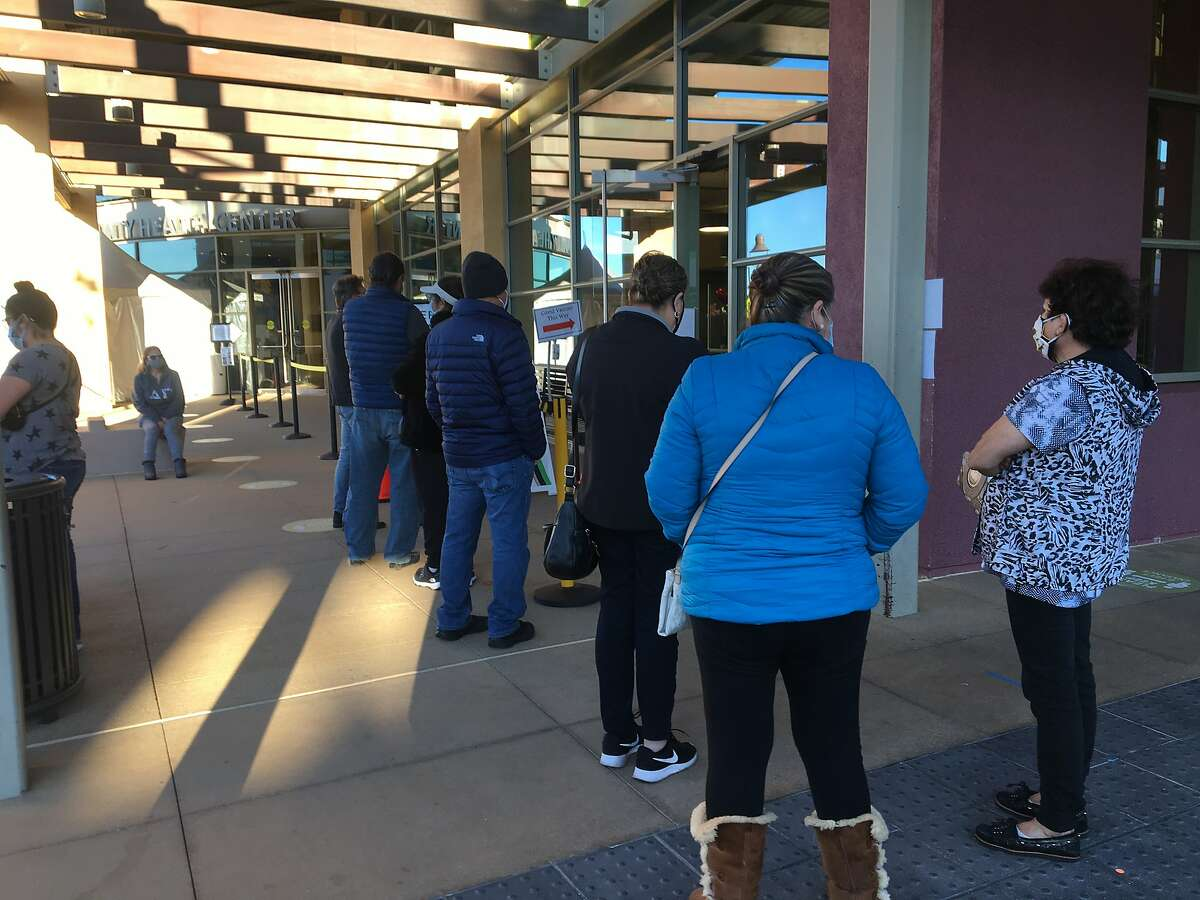 People line up outside the West County Health Center in San Pablo to see if they could get a leftover vaccine dose.