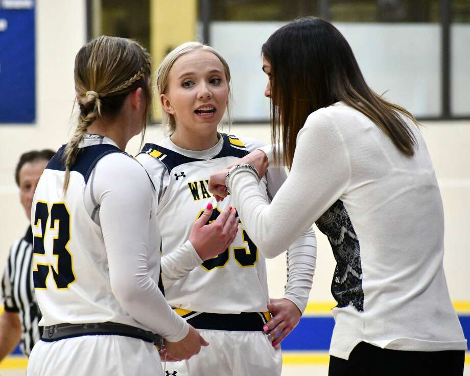 Wayland Baptist's Jenna Cooper (middle) talks strategy with head coach Alesha Ellis (right) and teammate Ashlyn Shelly during their 108-78 win over SAGU on Thursday. Photo: Nathan Giese/Planview Herald