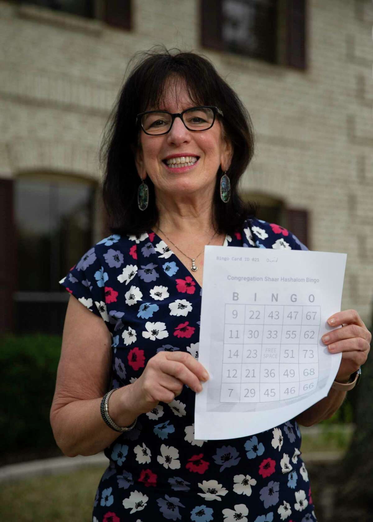 Congregation Shaar Hashalom organizer Sandy Ostrosky delivers a bingo prize in Clear Lake.