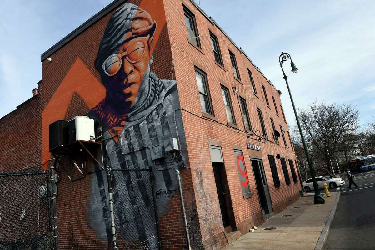 A mural of jazz legend Sun Ra on the building housing Cafe Nine on Crown Street in New Haven painted by Mike Deangelo in November of 2020 photographed on January 25, 2021.