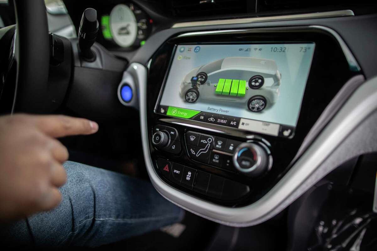 Classic Chevrolet Sugar Land sales consultant Edward Jackson Davis shows the battery level on the dash screen of a Chevrolet Bolt EV, Thursday, Feb. 4, 2021, in Sugar Land. The Bolt EV is a front-motor, five-door all-electric car.