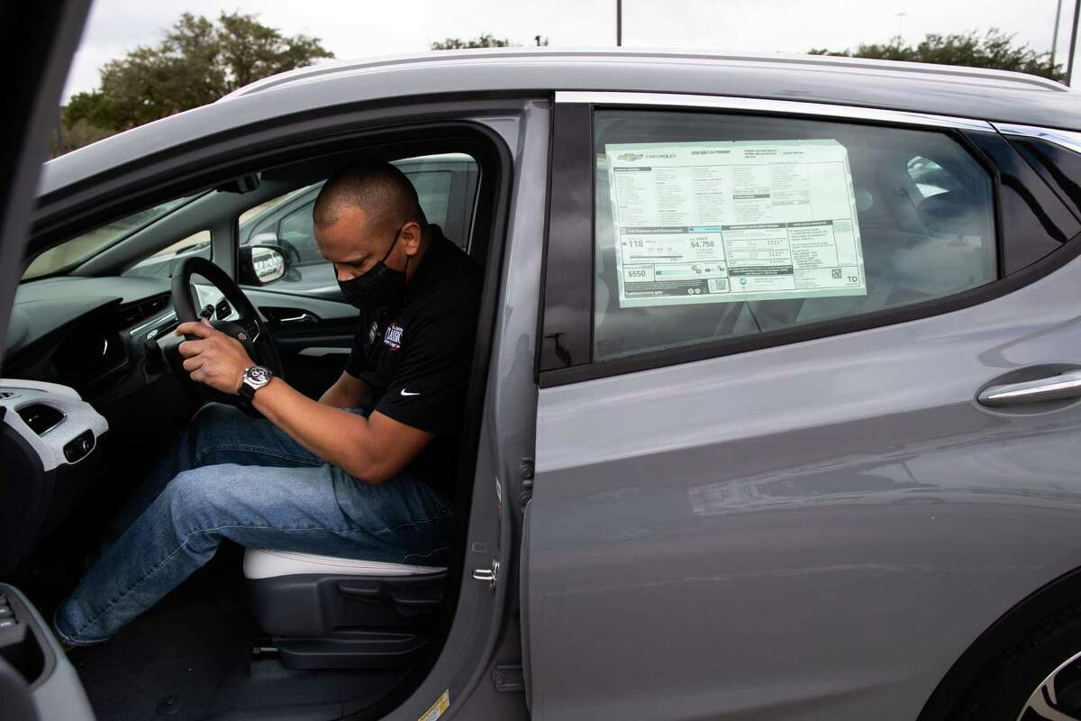 Classic Chevrolet Sugar Land sales consultant Edward Jackson Davis shows a Chevrolet Bolt EV, Thursday, Feb. 4, 2021, in Sugar Land. The Bolt EV is a front-motor, five-door all-electric car.