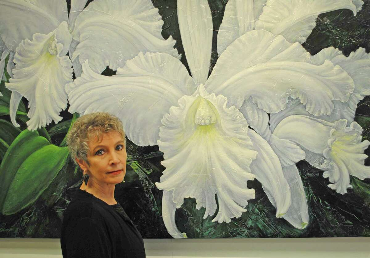 Artist Patricia Laspino in front of her painting