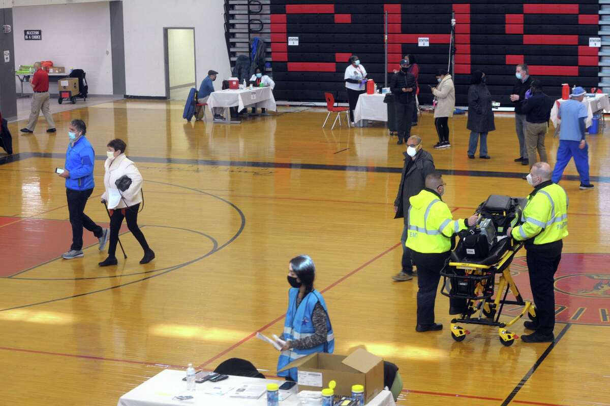 The COVID-19 vaccination clinic in the gymnasium of Central High School, in Bridgeport, Conn. Jan. 20, 2021.