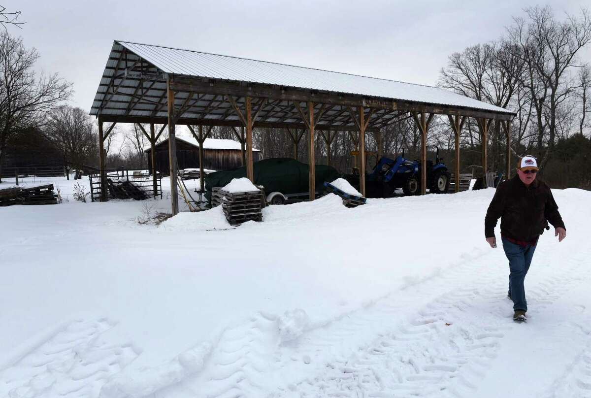 Louis Gnip walks through his family farmland on Friday, Feb. 5, 2021, on Brownell Road in Malta, N.Y. Gnip is working to preserve the family farm from development. (Will Waldron/Times Union)