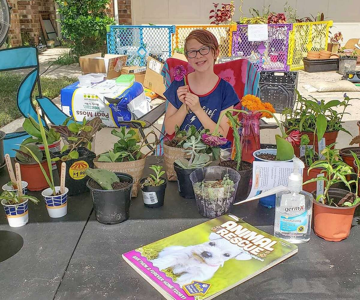 Fish has her table prepared with a variety of starter plants and items for trade at her Trade Day in September 2020.