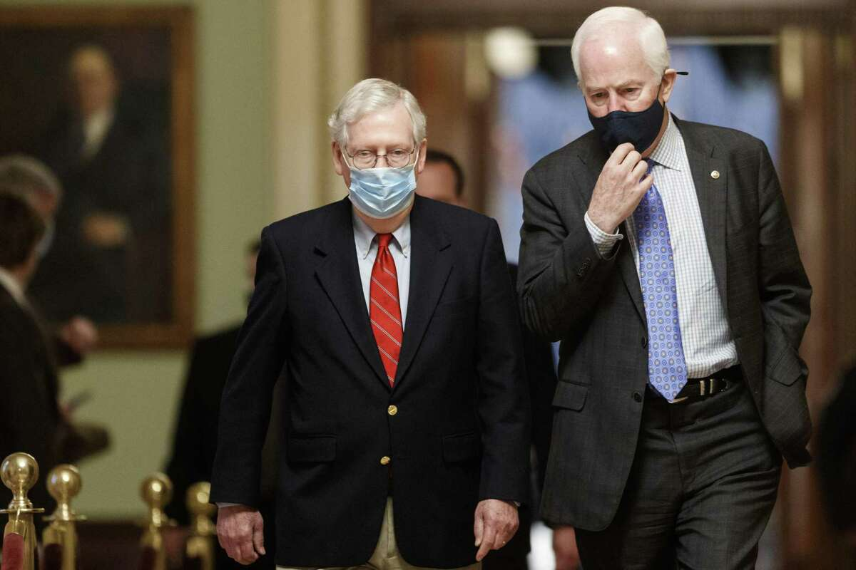 Texas Sen. John Cornyn, pictured here in December with then-Senate Majority Leader Mitch McConnell, has signaled he will vote against convicting former President Donald Trump in a second impeachment trial. He should reconsider.
