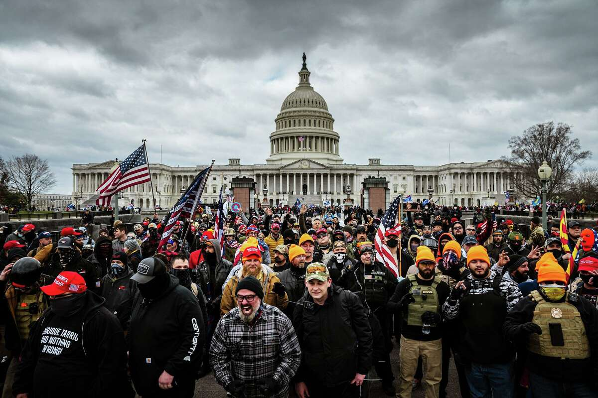 Trump supporters gather in front of the U.S. Capitol on Jan. 6. You impeach and convict to quash the rhetorical and physical assault on our democracy.