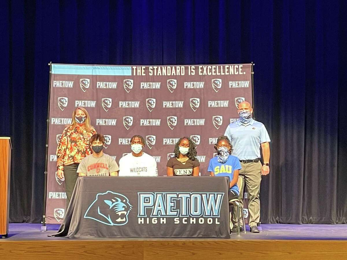 Paetow seniors (from left) Ryan Porter (Cornell), Damon Bankston (Weber State), Tumi Onaleye (Penn) and Logan Warren (Southern Arkansas) celebrated National Signing Day, Feb. 5 at Paetow High School.
