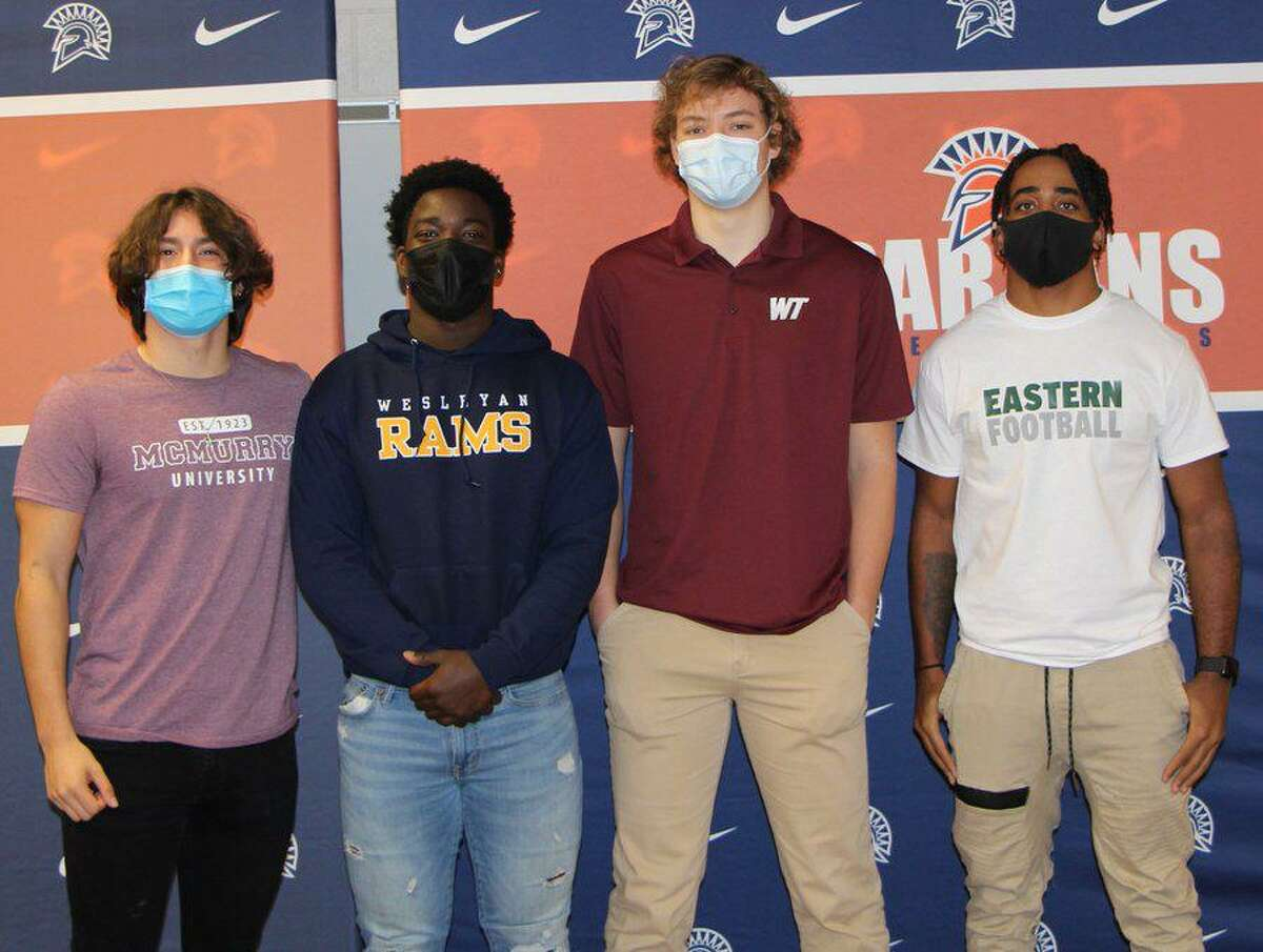Seven Lakes football players (from left) Emilio Ramos (McMurry), Nick David-West (Texas Wesleyan), Sam Treadaway (West Texas A&M)and Milton Jones (Eastern New Mexico) celebrated National Signing Day, Feb. 3 at Seven Lakes High School.