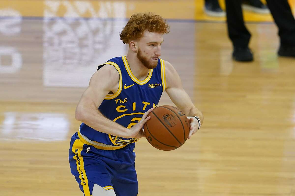 Golden State Warriors guard Nico Mannion (2) against the New York Knicks during an NBA basketball game in San Francisco, Thursday, Jan. 21, 2021. (AP Photo/Jeff Chiu)