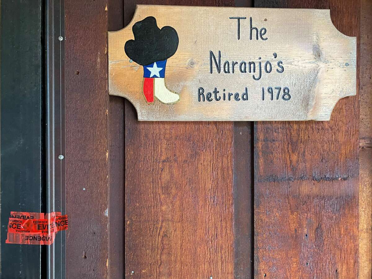 Remnants of crime tape remain on the door of Guadalupe Naranjo's home in Jasper on Friday morning. Investigators say the 80-year-old was fatally shot and stabbed. Read our earlier story for more. Kim Brent / The Enterprise