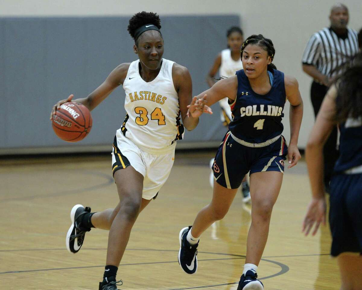 Da'Necia Trusty (34) of Alief Hastings is guarded by Quinnia Nolan (4) of Klein Collins as she dribbles past mid-court during the second half of a high school basketball game between the Alief Hastings Bears and the Klein Collins Tigers at the Katy Classic Basketball Tournament on Friday, December 6, 2019 at Cinco Ranch HS, Katy, TX.