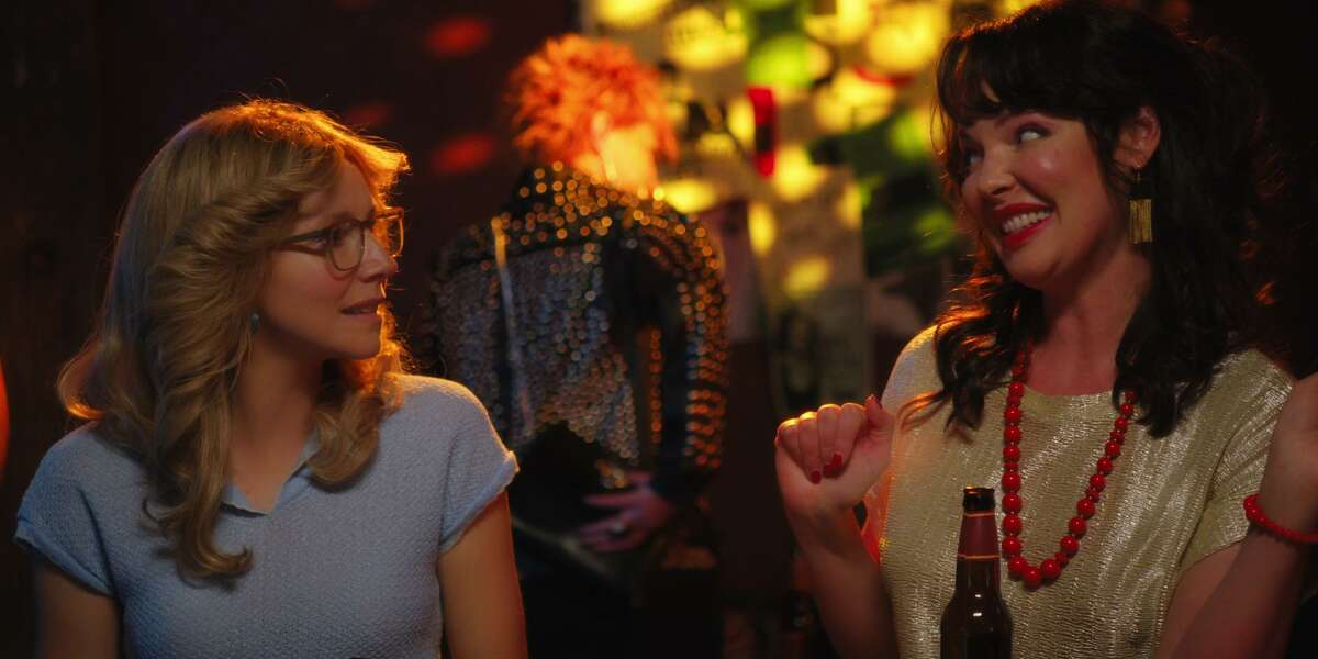 """Actress Katherine Heigl (right) is seen wearing Jewels for Hope earrings in a scene with Sarah Chalke in episode one of Netflix's """"Firefly Lane."""""""