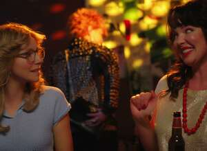 "Actress Katherine Heigl (right) is seen wearing Jewels for Hope earrings in a scene with Sarah Chalke in episode one of Netflix's ""Firefly Lane."""