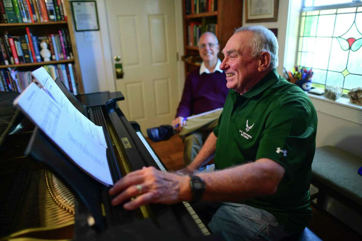 While learning to play an instrument is rarely easy, adults such as Harold Smarkola, right, playing for teacher Thomas Masinter, usually don't face the same pressures - such as preparing for recitals or worrying about grades - as children.