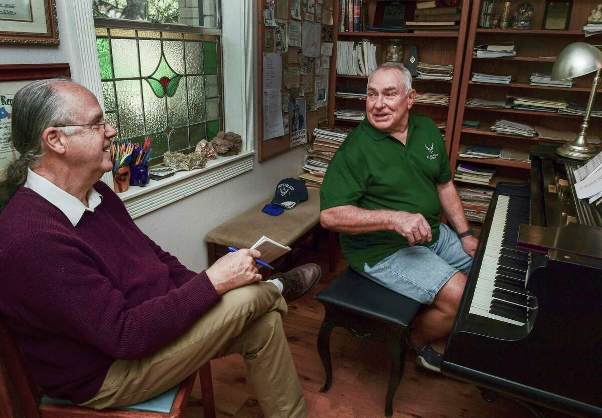 Harold Smarkola, right, until May had never played a musical instrument in his life. He listens to advice from his piano teacher Thomas Masinter.
