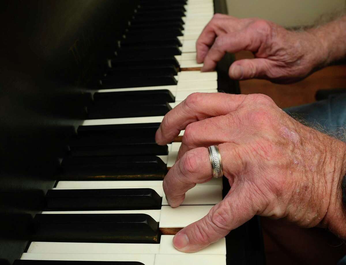 Harold Smarkola, who started taking lessons in May, plays the piano.