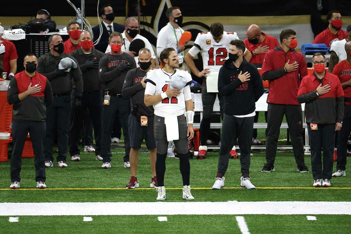 Tom Brady (shown in the background) will get some screen time during the national anthem, but will he be shown on the broadcast before Patrick Mahomes?
