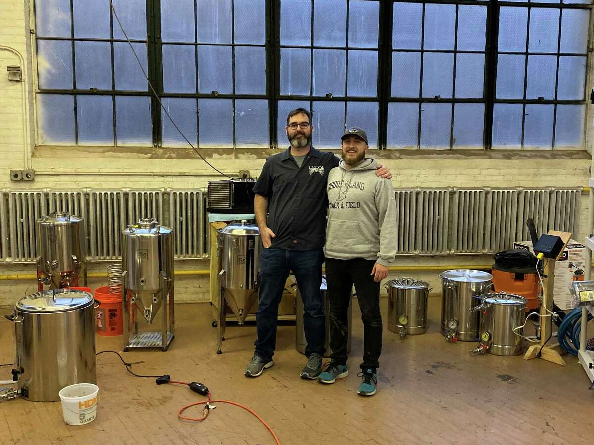 James Bloom, right, the founder of Spacecat Brewing Co. in South Norwalk, with friend and mentor Jeff Dunn. Bloom plans to open Spacecat in May.