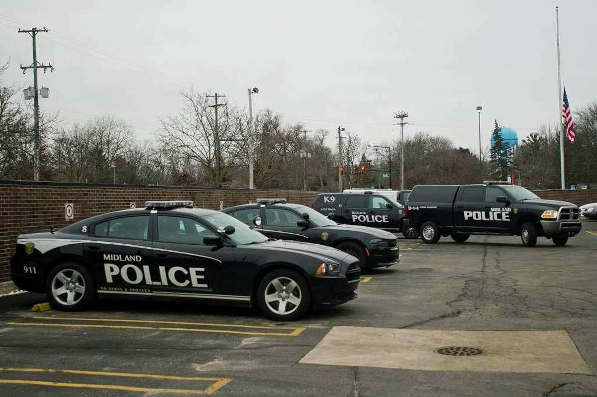 FILE -- A police vehicle exits a parking lot at the Law Enforcement Center at 2727 Rodd St. on Thursday, Jan. 25, 2018. (Katy Kildee/kkildee@mdn.net)