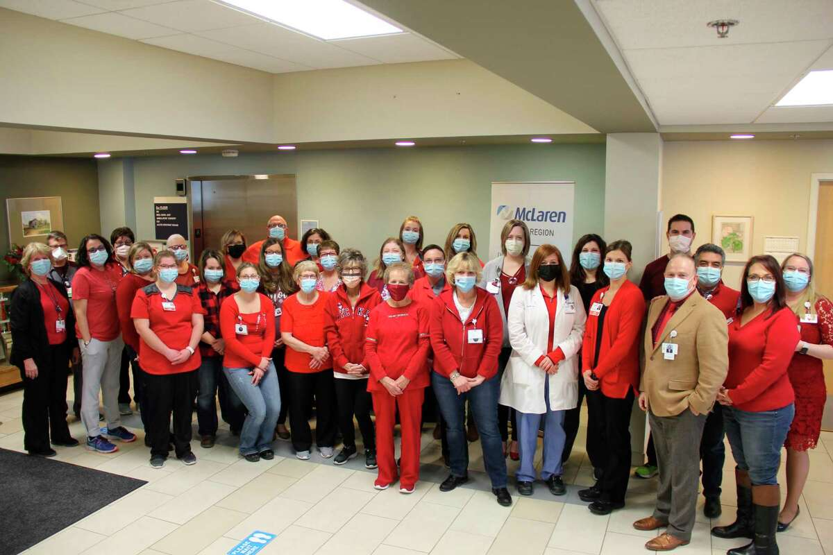 McLaren employees pose for a photo wearing red on the first Friday of February. February is American Heart Month and the staff members are showing their awareness of heart disease, particularly in women. (Robert Creenan/Huron Daily Tribune)