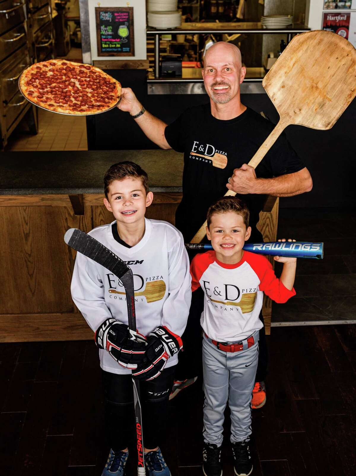 Michael Androw, the owner of E&D Pizza Company in Avon, with his sons Enzo and Dario, for whom the restaurant is named.