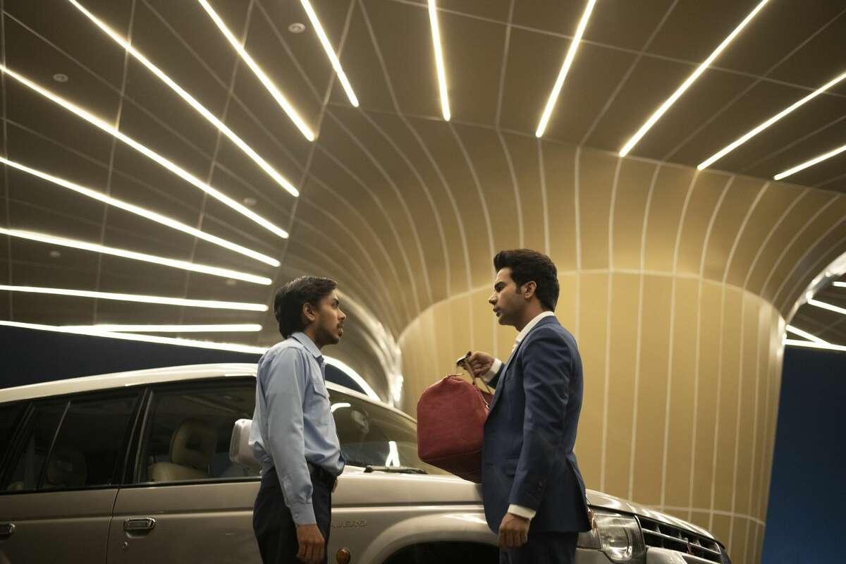 """Adarsh Gourav (Balram) and Rajkummar Rao (Ashok) in """"The White Tiger."""""""