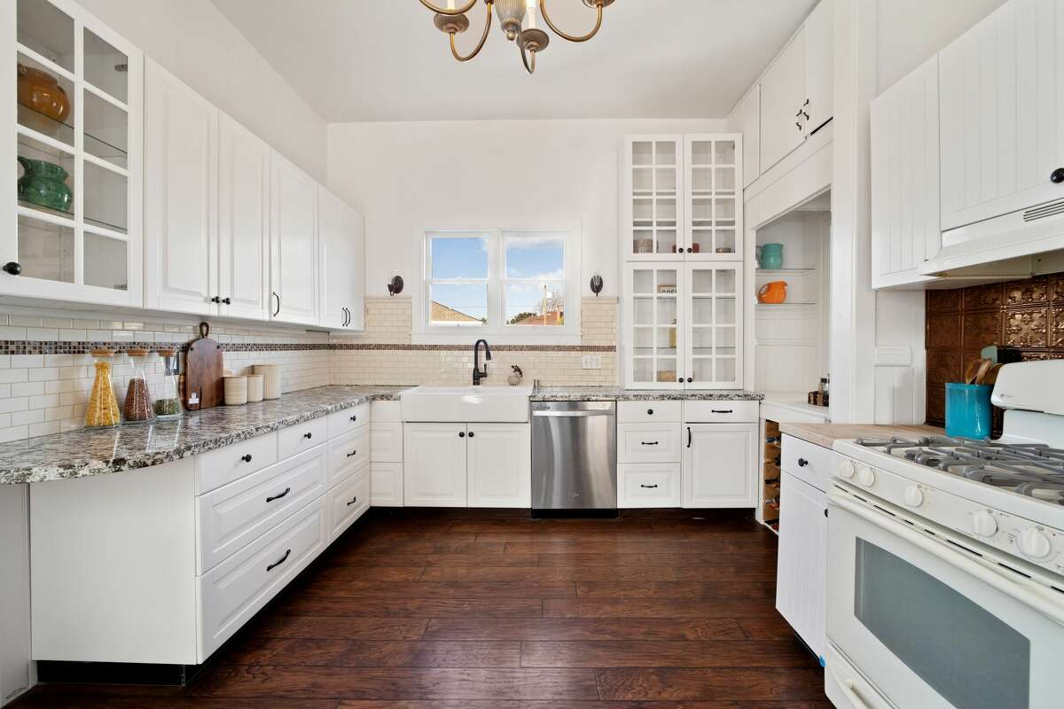 The kitchen offers generous space for cooking and storage.