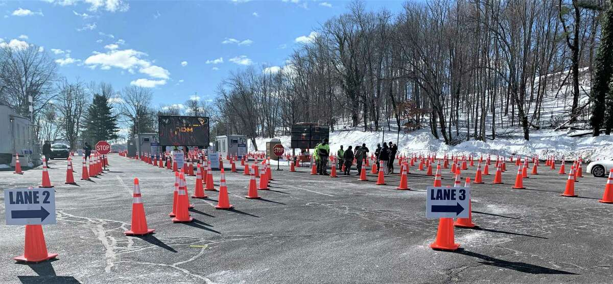 The Community Health Center's drive-through COVID-19 mass vaccination clinic is held in parking lot V of Wesleyan University, 75 Vine St., Middletown.