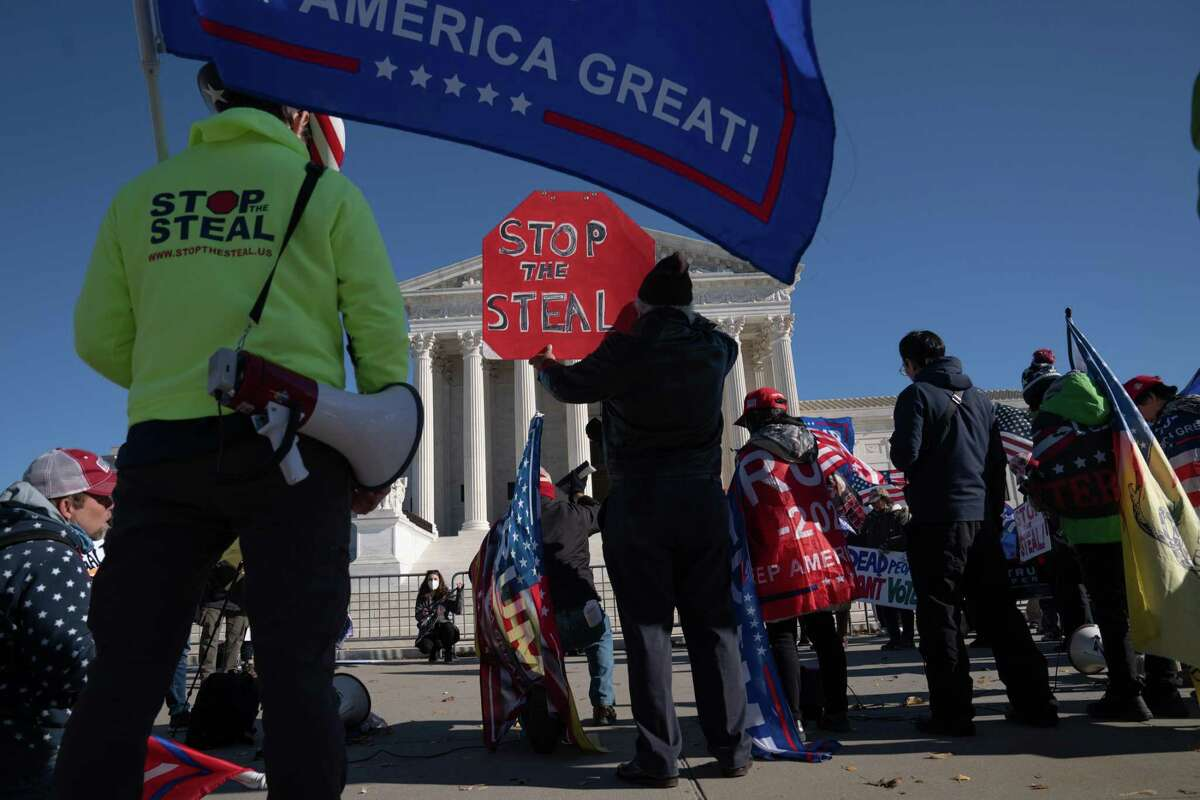 FILE -- Protesters outside the Supreme Court in Washington, Dec. 8, 2020. Many Republican grass-roots donors were drawn in by former President Donald Trump's false promises and