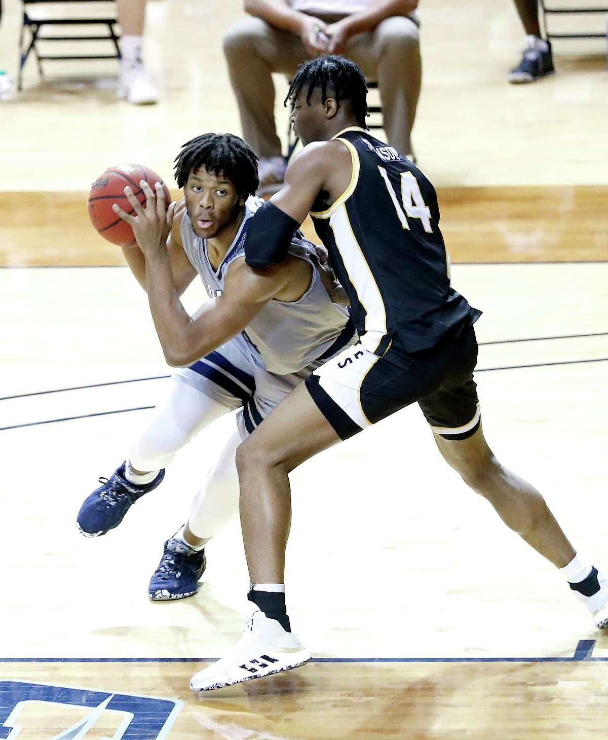 Rice Owls forward Mylyjael Poteat (34) works against Southern Miss Golden Eagles forward Tyler Stevenson (14) during the first half of an NCAA men's basketball game at Tudor Field House in Houston, Friday, Feb. 5.
