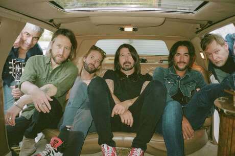 "Foo Fighters, from left: Pat Smear, Chris Shiflett, Taylor Hawkins, Dave Grohl, Rami Jaffee and Nate Mendel, in Los Angeles, Jan. 13, 2021. The band's new album, ""Medicine at Midnight,"" is a slight pivot. (Magdalena Wosinska/The New York Times)"
