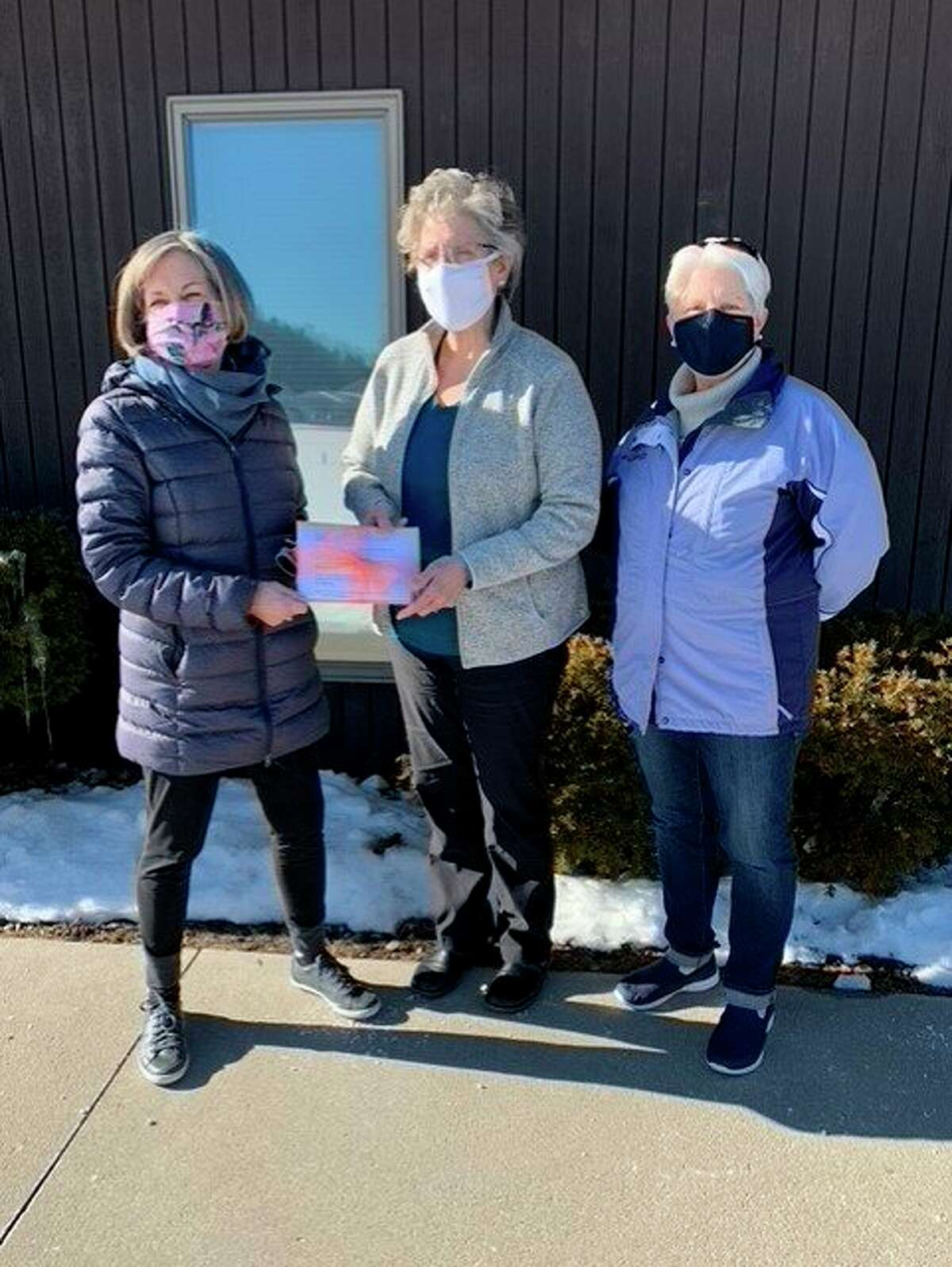 Molly Harrison, 100+Women Who Care member and BACN board member, presents a check to Gerri Van Antwerp, executive director of BACN, with Ann Henning,100+ Women Who Care member and Community Outreach member for BACN. (Courtesy Photo)