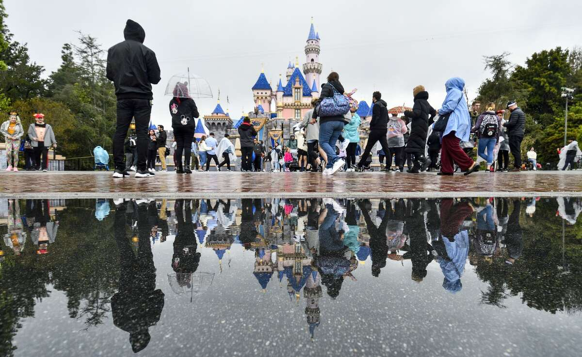 Visitors in front of Sleeping Beauty Castle on the last day before Disneyland closed because of the COVID-19 outbreak.