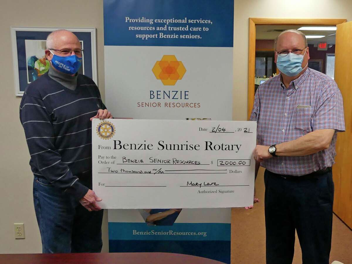 Dave Wynne from theRotary Sunrise Foundation presents a symbolic big check to Doug Durand, executive director of Benzie Senior Resources. (Courtesy Photo)