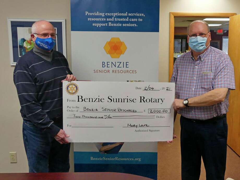 Dave Wynne from the Rotary Sunrise Foundation presents a symbolic big check to Doug Durand, executive director of Benzie Senior Resources. (Courtesy Photo)